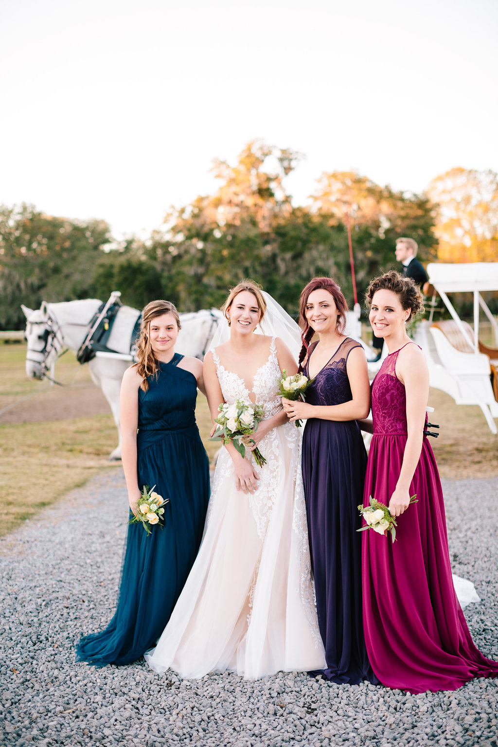 Bridal Party at Sugah Cain Plantation  //  Charleston wedding vendor - Verita Bridal Boutique  Bride and her maids at Sugah Cain Plantation in front of white horse and Carriage  //  on A Lowocountry Wedding Magazine & Blog