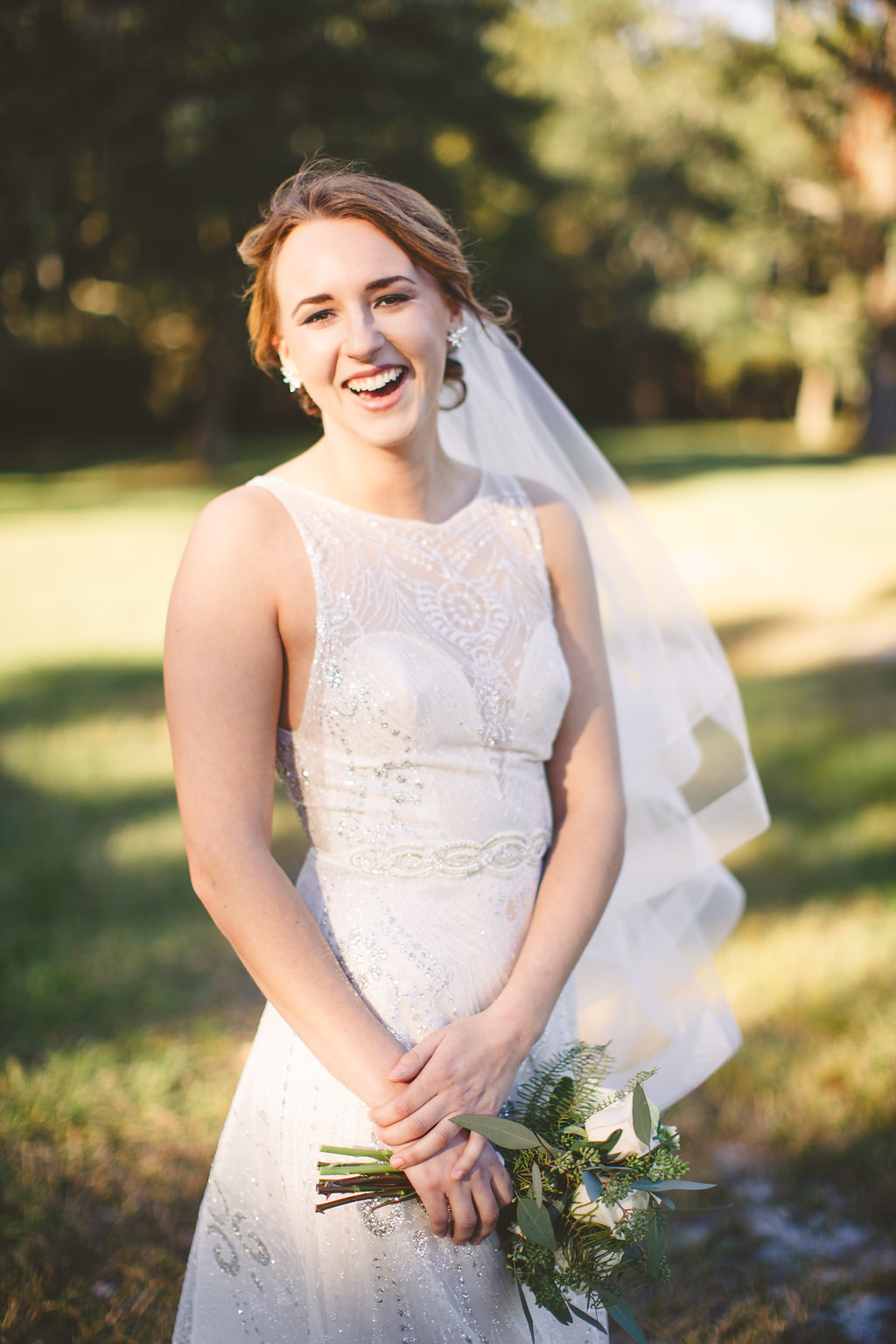 Bride with hair and makeup from Canary Rock Salon at Sugah Cain Plantation  //  Charleston, SC Wedding Photography by Carolina Photosmith  Bride and her maids at Sugah Cain Plantation in front of white horse and Carriage  //  on A Lowocountry Wedding Magazine & Blog