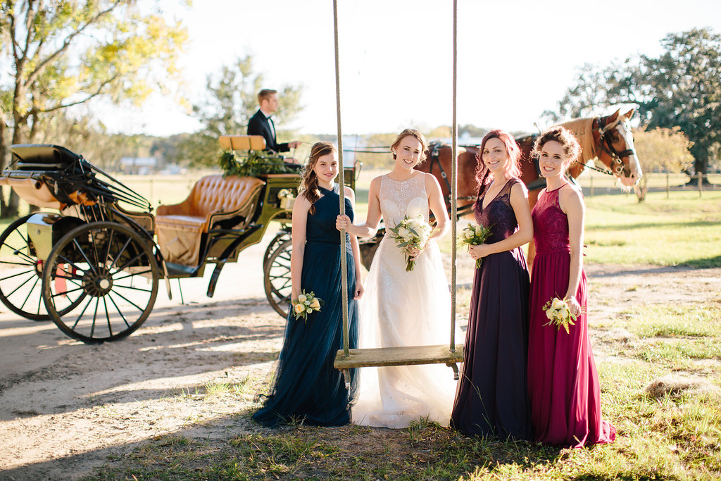 Elegant black horse and carriage from Old South Carriage Company at Sugah Cain Plantation  //  Bride and her maids at Sugah Cain Plantation in front of white horse and Carriage  //  on A Lowocountry Wedding Magazine & Blog