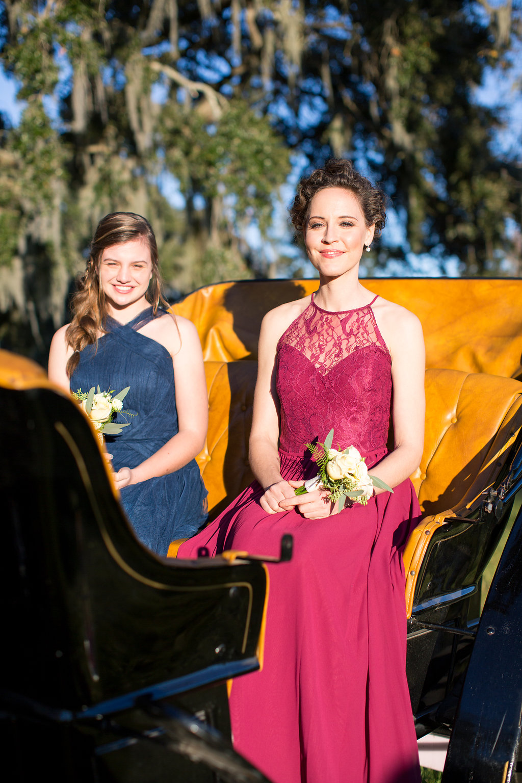 Bridesmaids in Hayley Paige dresses in a black horse and carriage from Old South Carriage Company  //  Sugah Cain Plantation  Bride and her maids at Sugah Cain Plantation in front of white horse and Carriage  //  on A Lowocountry Wedding Magazine & Blog