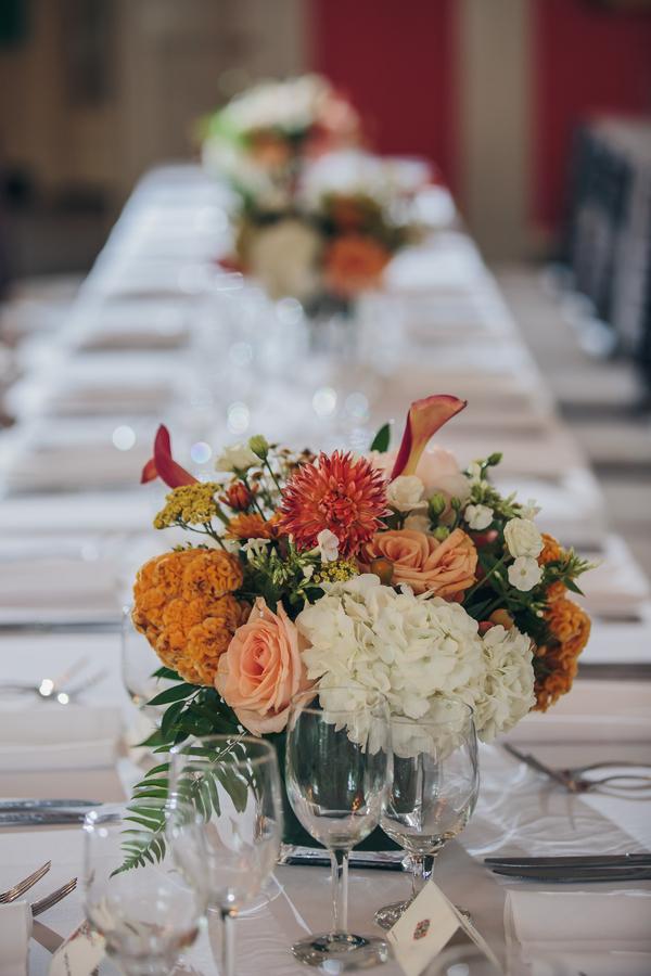 Peach centerpieces by Charleston Flower Market at William Aiken House wedding  // A Lowcountry Wedding Magazine & Blog