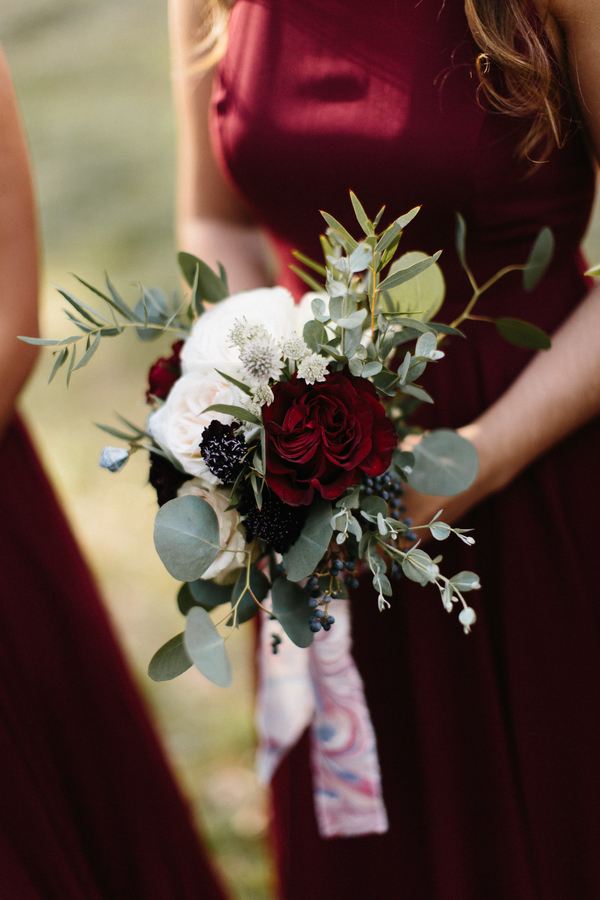 Cranberry bridesmaids desses with winter bouquets by Gertie Mae's Florals at The King & Prince Resort  //  A Lowcountry Wedding Magazine & Blog