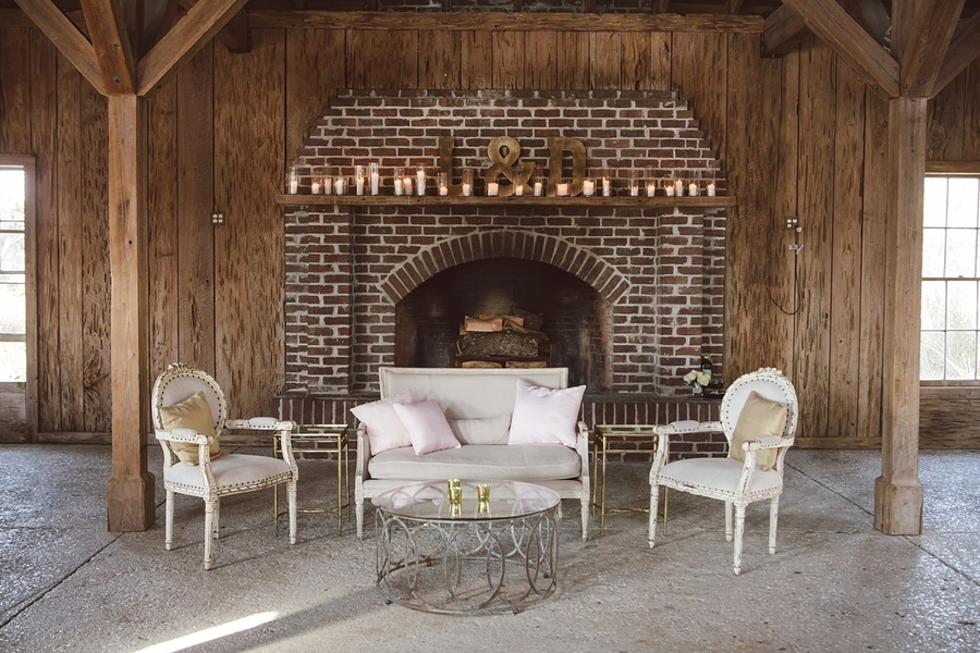 Lounge furniture set up The Cotton Dock in front of the fireplace  //  Charleston wedding photos by amelia + dan photography  //  A Lowcountry Wedding Magazine & Blog