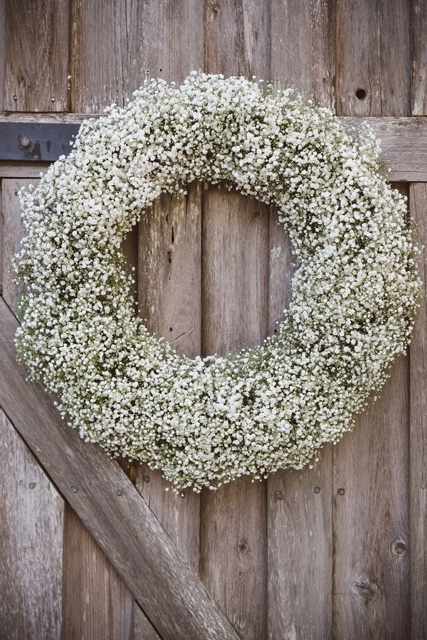 Baby's breath door wreath at The Cotton Dock  //  Charleston wedding photos by amelia + dan photography  //  A Lowcountry Wedding Magazine & Blog