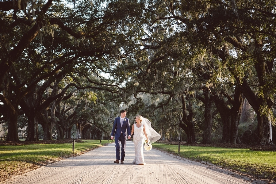 Bride & Groom under the Avenue of Oaks at Boone Hall Plantation //  Charleston wedding photos by amelia + dan photography  //  A Lowcountry Wedding Magazine & Blog
