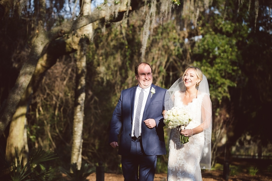 Father of the bride walking down the aisle with his daughter at The Cotton Dock  //  Charleston wedding photos by amelia + dan photography  //  A Lowcountry Wedding Magazine & Blog