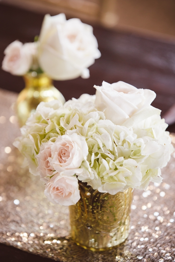 Gold table runners with white hydrangea, roses and pink spray rose centerpieces at Boone Hall Plantation Cotton Dock  //  Charleston wedding planner ELM Events  //  A Lowcountry Wedding Magazine & Blog