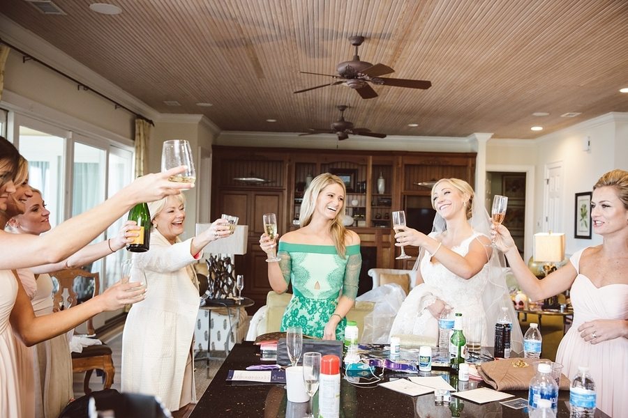 Bride and her bridesmaids sipping champagne before her wedding //  Charleston wedding photos by amelia + dan photography  //  A Lowcountry Wedding Magazine & Blog