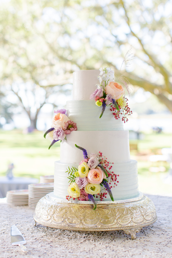 Four-tiered cake with floral accents at Oak Point Plantation wedding on Johns Island, SC  //  Charleston wedding photographer Riverland Studios  //  A Lowcountry Wedding Magazine & Blog