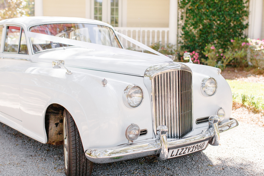 White vintage Rolls Royce from Lowcountry Valet & Shuttle Co. //  Oak Point Plantation wedding  //  A Lowcountry Wedding Magazine & Blog