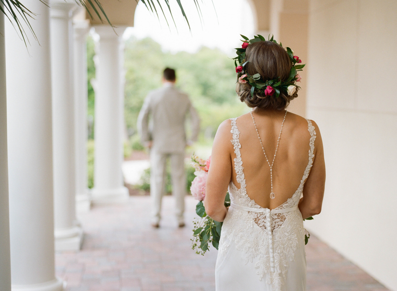 Bride wearing floral crown and backdrop necklace at Grande Dunes Ocean Club  //  Myrtle Beach wedding photos by Gillian Claire Photography  //  A Lowcountry Wedding Magazine & Blog