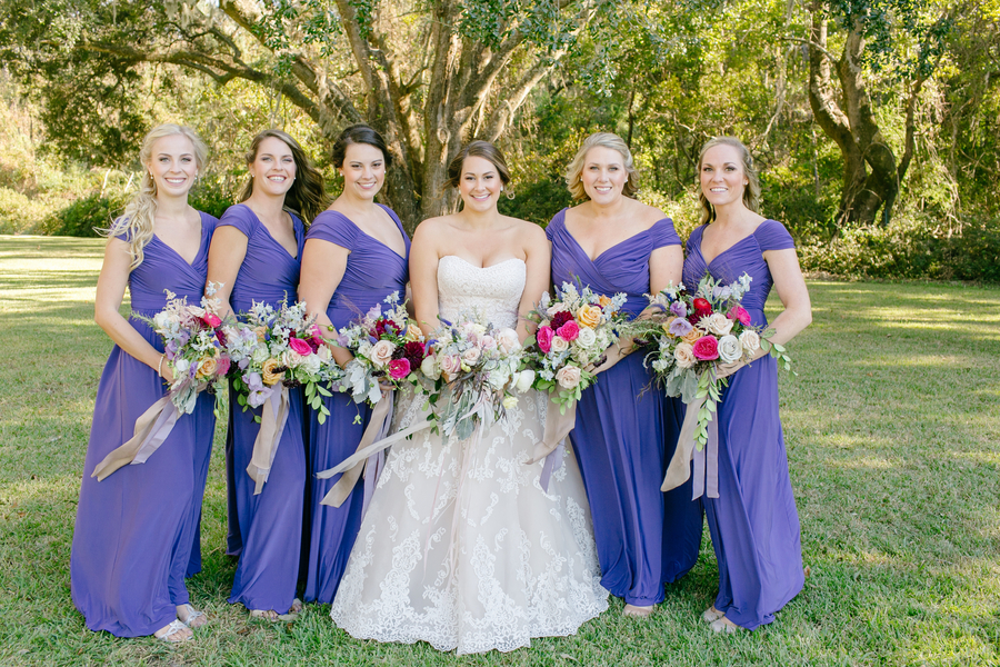 Bridesmaids in long blue, off-the-shoulder dresses at Oak Point Plantation  //  A Lowcountry Wedding Magazine & Blog