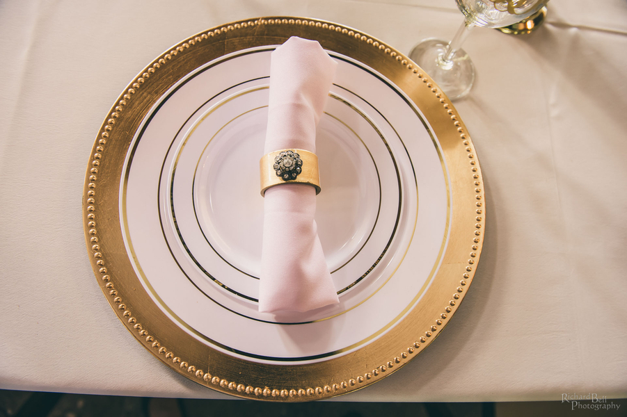 Gold and white place setting at The Cotton Dock designed by Posh Petals & Pearls //  A Lowcountry Wedding Magazine & Blog