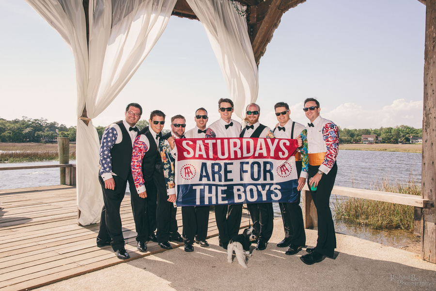 "Groomsmen with a bar stools sports ""Saturdays are for the boys"" flag //  A Lowcountry Wedding Magazine & Blog"