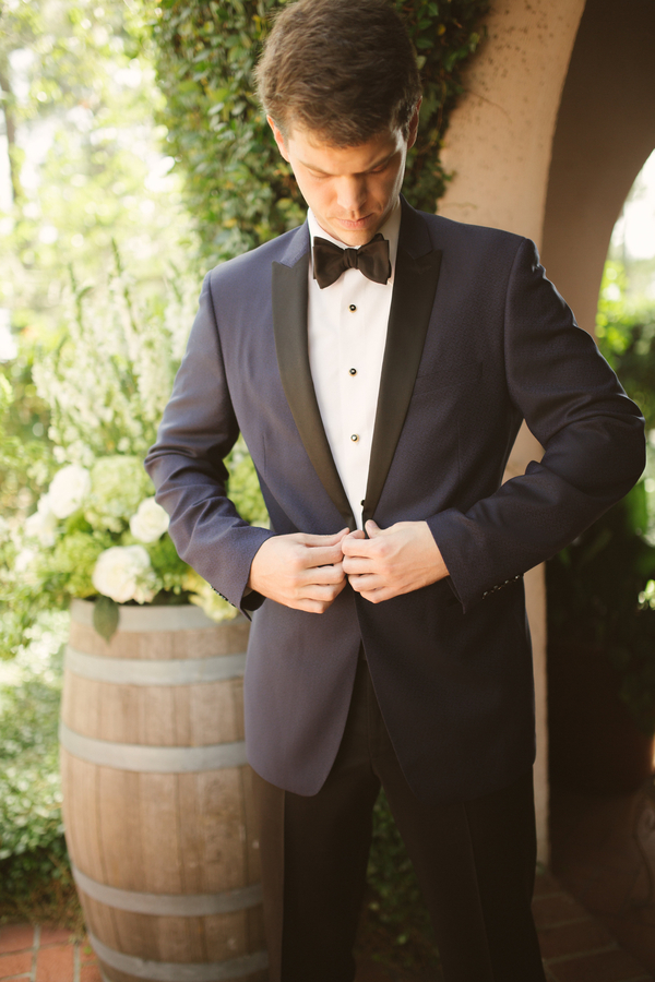Groom wearing navy blue dinner jacket and black bow tie  //  Hilton Head wedding photos by Christi Clark Photography  //  A Lowcountry Wedding Magazine & Blog