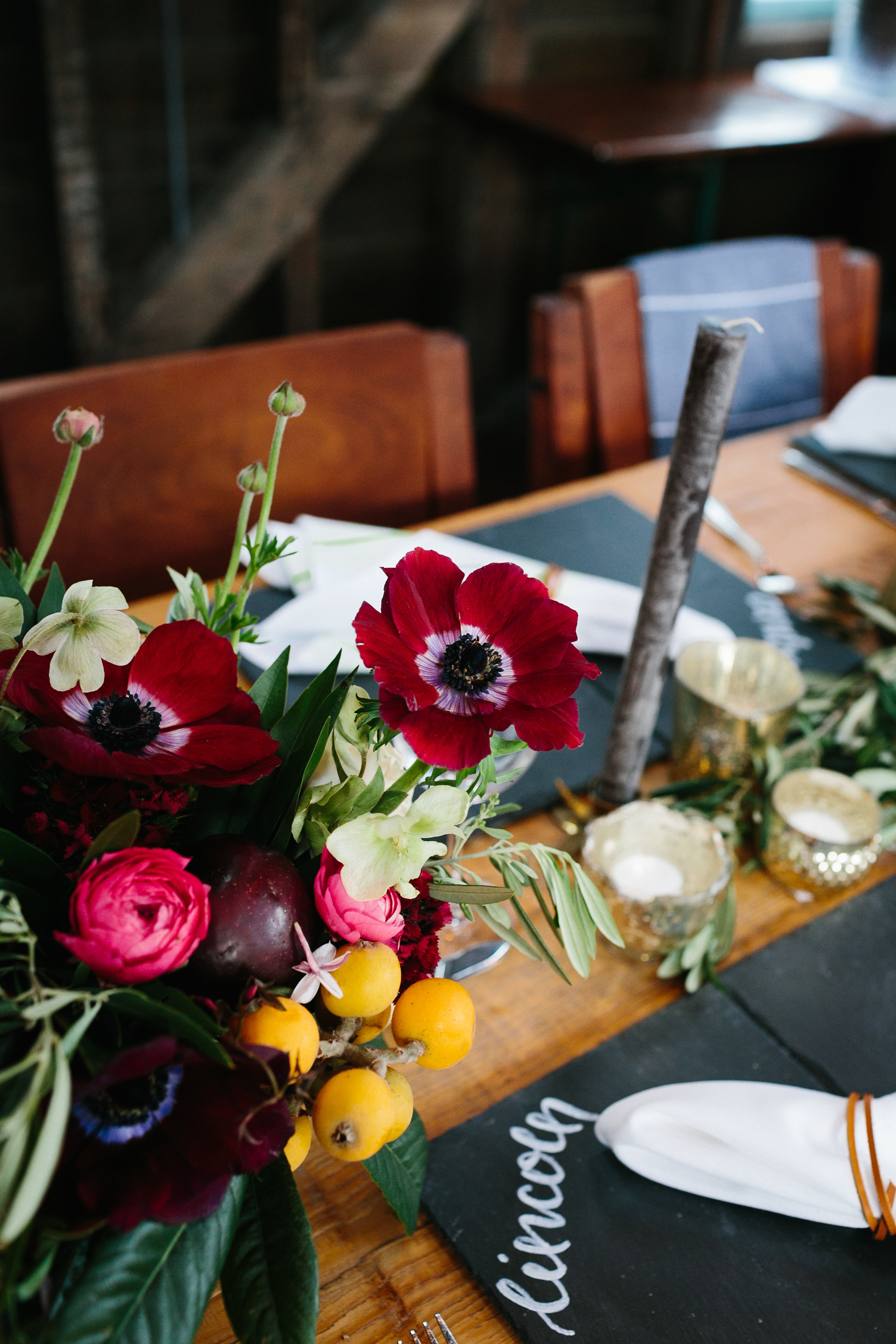 Moody floral centerpieces and slate placemats by The Petal Report  //  Charleston photos by Elizabeth Ervin  //  A Lowcountry Wedding Magazine & Blog