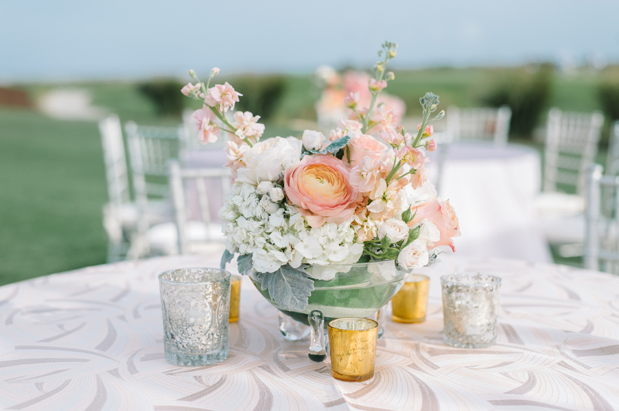 Spring floral centerpieces with peach ranunculus, roses and hydrangeas by Branch Design Studio