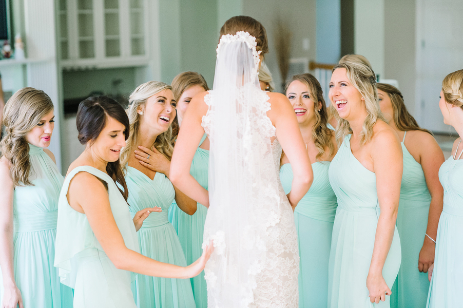 Bridesmaids in long mint Azazie dresses at Kiawah wedding at The Ocean Course  //  photographed by Aaron and Jillian Photography  //  A Lowcountry Wedding Magazine