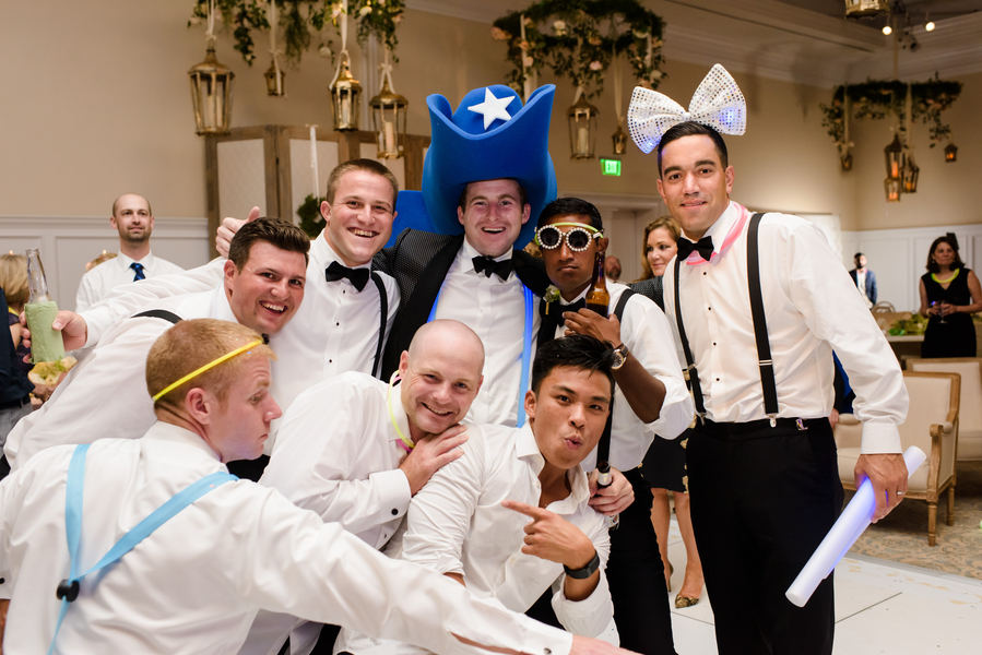 Groomsmen wearing big hats on the dance floor //  Hilton Head Island wedding photos by Donna Von Bruening  //  A Lowcountry Wedding Magazine & Blog