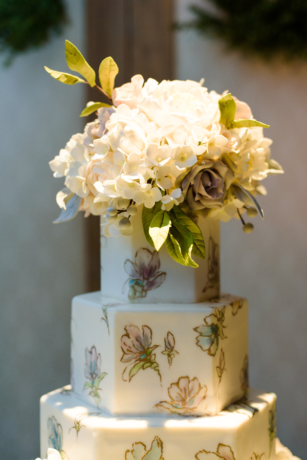 White hydrangea floral topper on a five-tiered Minette Rushing Custom Cake at Palmetto Bluff  //  Hilton Head Island wedding photos by Donna Von Bruening  //  A Lowcountry Wedding Magazine & Blog