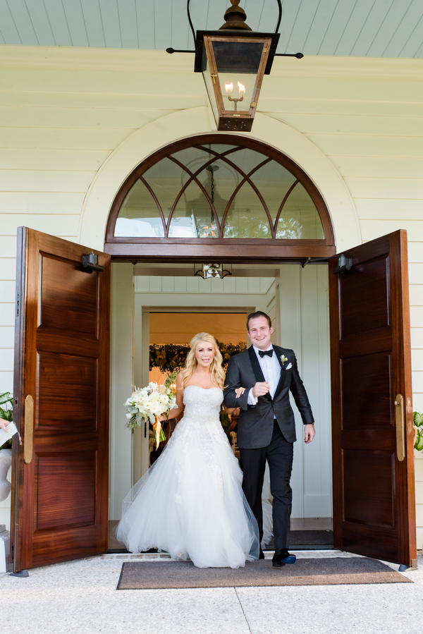 Bride and groom exit May River Chapel  //  Hilton Head Island wedding photos by Donna Von Bruening  //  A Lowcountry Wedding Magazine & Blog