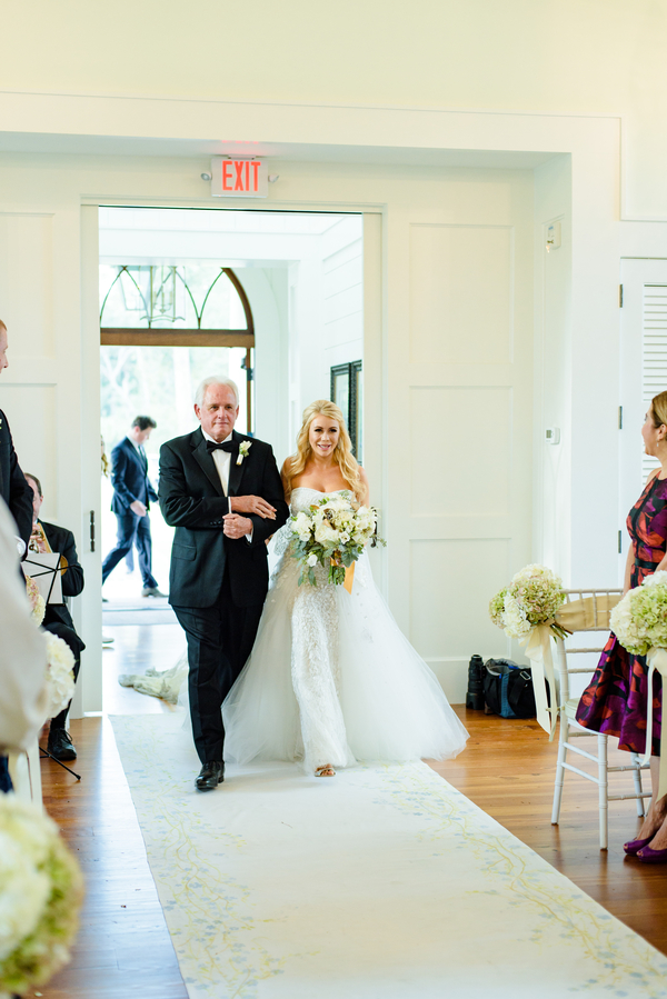 Father of the bride walking daughter down the aisle at May River Chapel  //  Hilton Head Island wedding photos by Donna Von Bruening  //  A Lowcountry Wedding Magazine & Blog