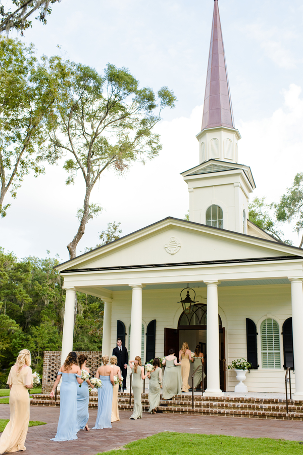 Bridesmaids entering May River Chapel at Palmetto Bluff  //  Hilton Head Island wedding photos by Donna Von Bruening  //  A Lowcountry Wedding Magazine & Blog