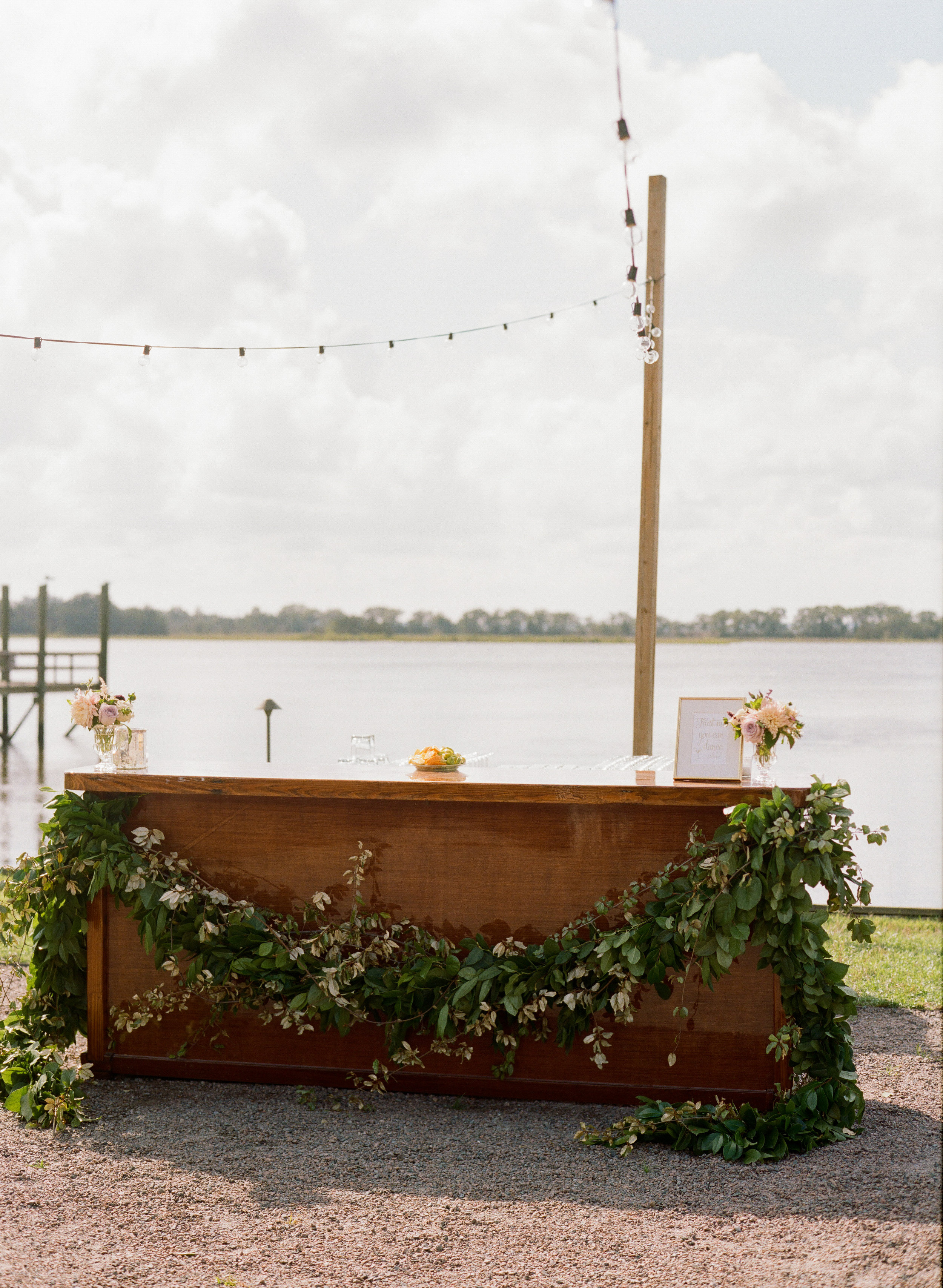 Rustic outdoor bar at Charleston SC wedding at The Island House
