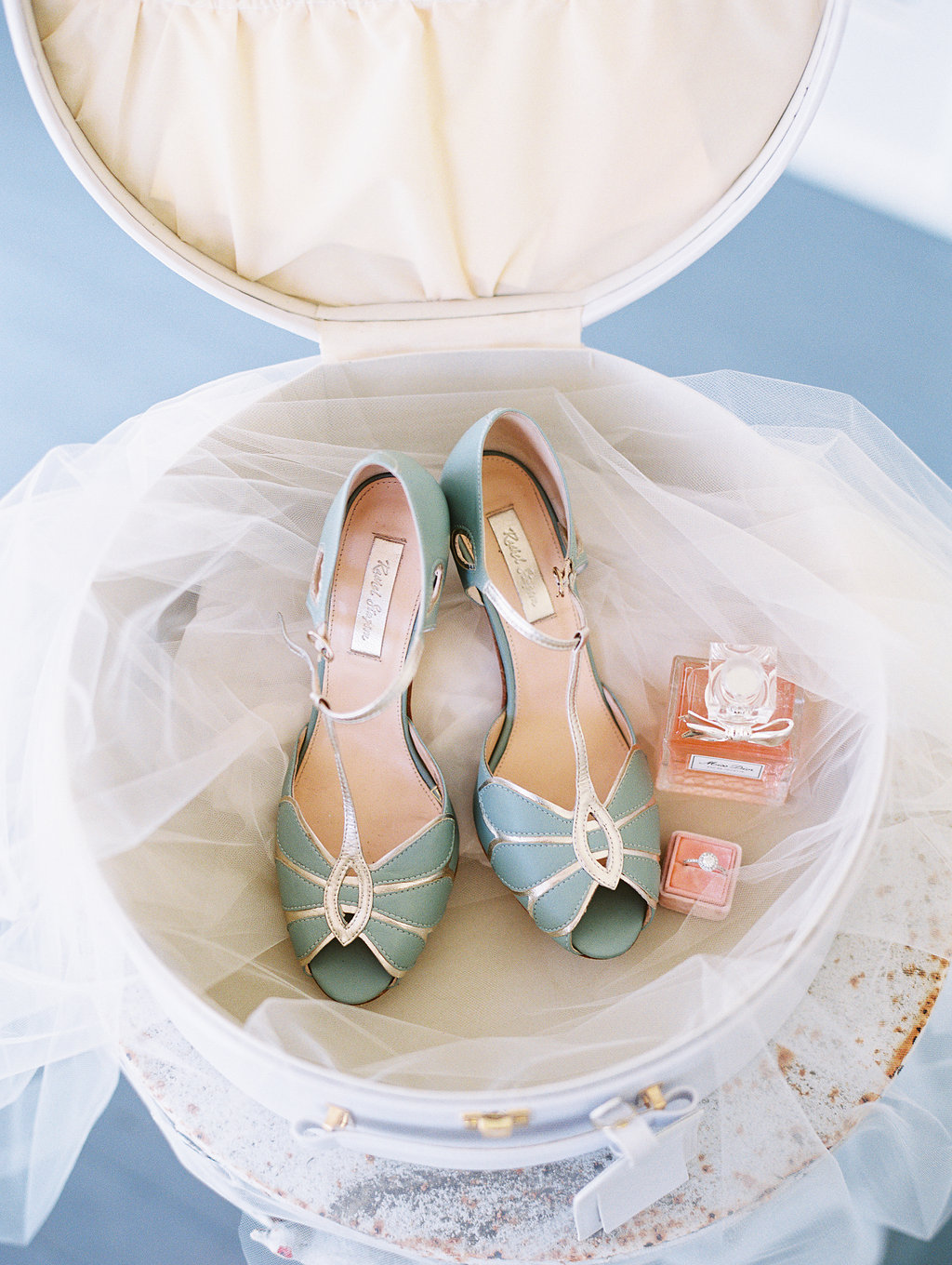 Bride's pale blue shoes photographed by Landon Jacob at Oldfield Club  //  A Lowcountry Wedding Magazine