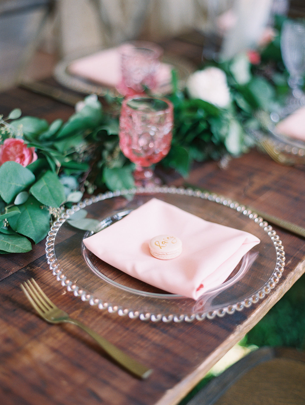 Rustic place setting with greenery table runners and blush accents at wedding in Hilton Head SC  Craft beer station at Oldfield Club wedding  //  HIlton Head photographs by Landon Jacobs  //  A Lowcountry Wedding Magazine