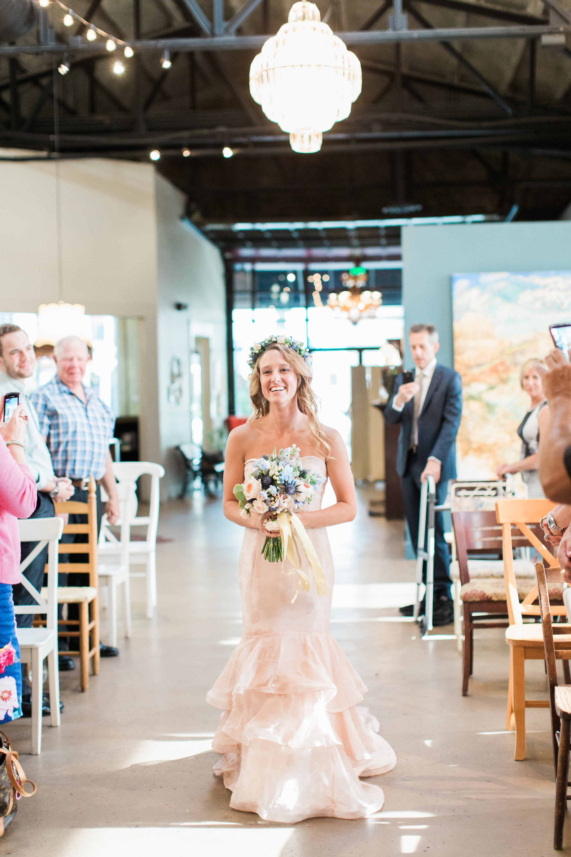 Bride walking down the aisle at Soho South Cafe wedding ceremony  //  A Lowcountry Wedding Magazine