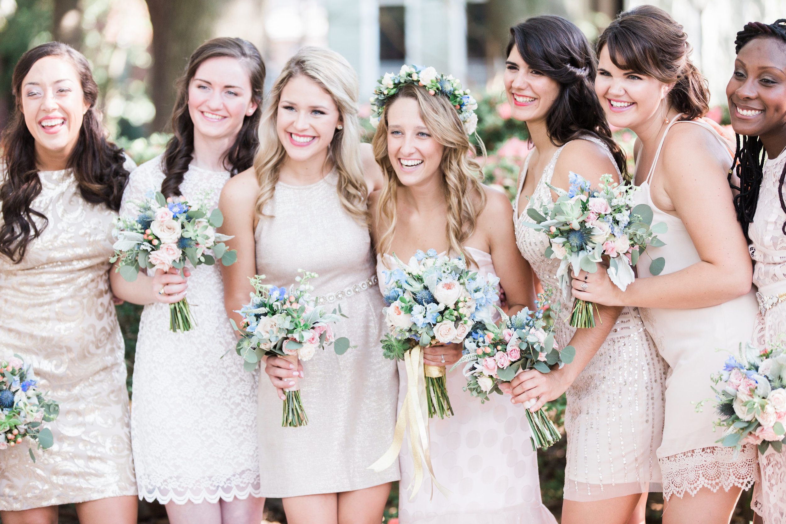 Bridesmaids wearing neutral cocktail dresses at wedding in Savannah GA