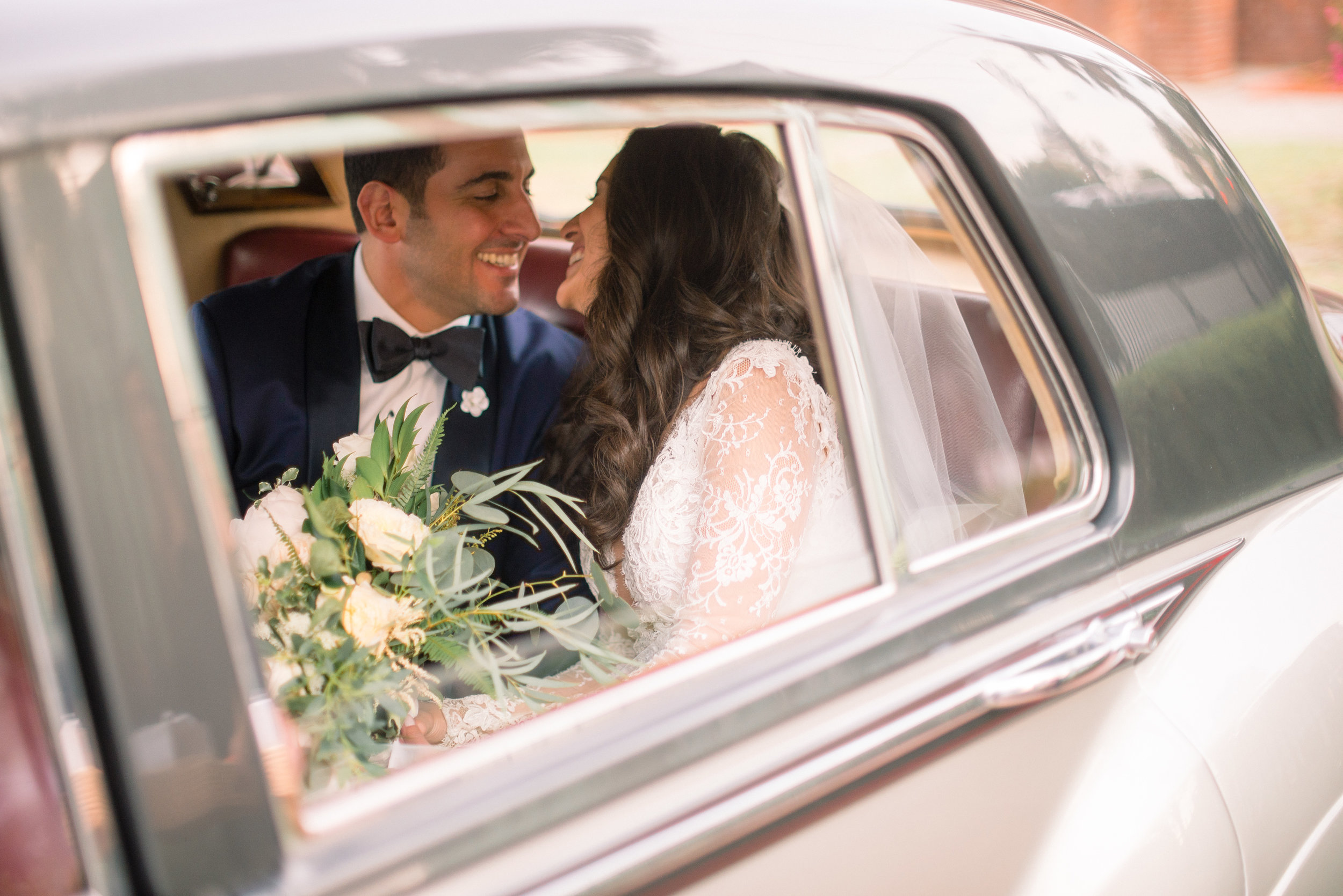 Charleston couple in a Vintage Rolls Royce at The Thomas Bennnett House  //  A Lowcountry Wedding Magazine & Blog