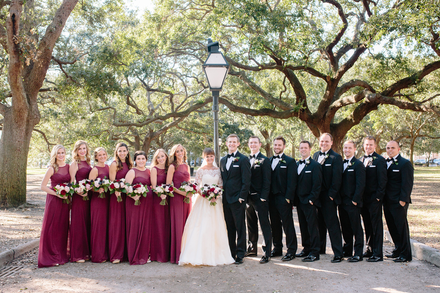 Bridesmaids in long cranberry dress and groomsmen in black tuxedoes  //  Charleston wedding photos by Riverland Studios  //  A Lowcountry Wedding Magazine & Blog