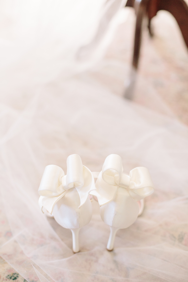 White wedding shoes with bows   //  Charleston wedding photos by Riverland Studios  //  A Lowcountry Wedding Magazine & Blog