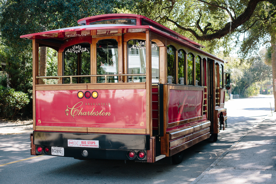 Red trolley from Absolutely Charleston   //  Charleston wedding photos by Riverland Studios  //  A Lowcountry Wedding Magazine & Blog
