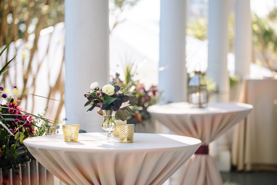 Cocktail tables on the porch with Fall centerpieces from Branch Design Studio  //  Charleston wedding photos by Riverland Studios  //  A Lowcountry Wedding Magazine & Blog