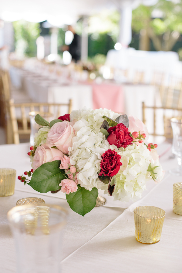 White hydrangea centerpiece with pink and red roses  Ceremony at Cathedral of St. John the Baptist   //  Charleston wedding photos by Riverland Studios  //  A Lowcountry Wedding Magazine & Blog