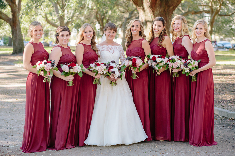 Bridesmaids in long cranberry dresses, bride in Modern Trousseau  Ceremony at Cathedral of St. John the Baptist   //  Charleston wedding photos by Riverland Studios  //  A Lowcountry Wedding Magazine & Blog
