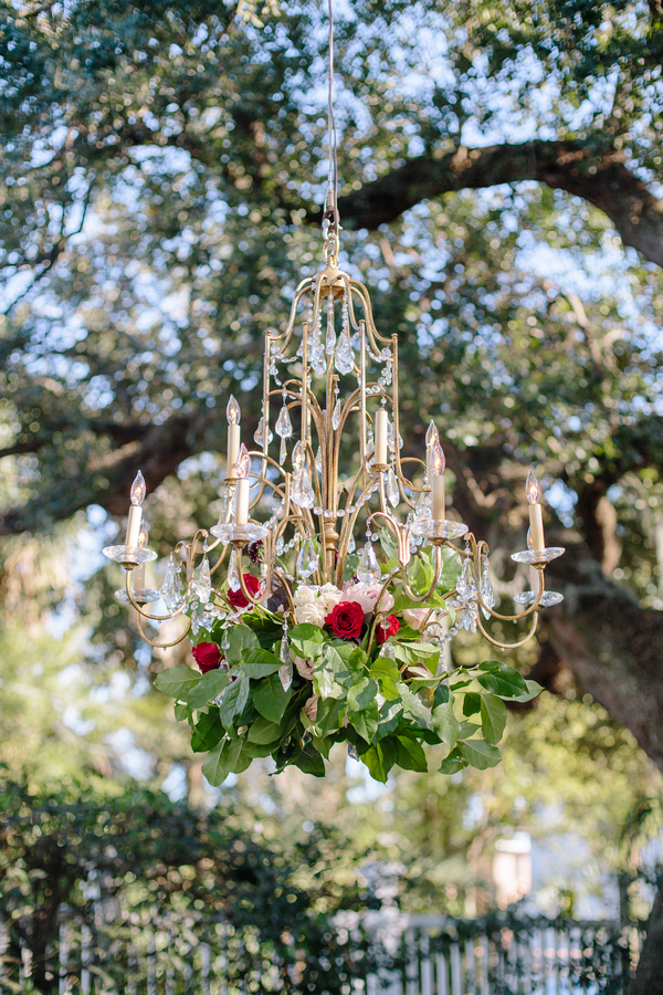Gold chandelier with floral accents  Ceremony at Cathedral of St. John the Baptist   //  Charleston wedding photos by Riverland Studios  //  A Lowcountry Wedding Magazine & Blog
