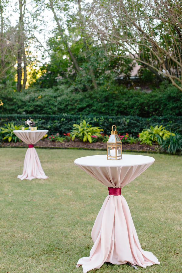Cocktail tables with pink linens and cranberry ties  Ceremony at Cathedral of St. John the Baptist   //  Charleston wedding photos by Riverland Studios  //  A Lowcountry Wedding Magazine & Blog