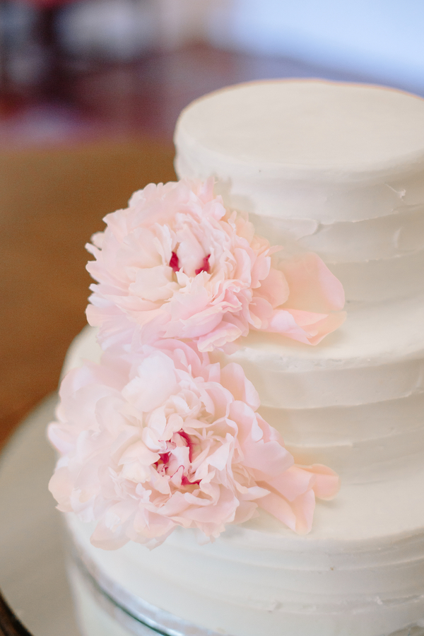 Three tiered white cake with pink peony accents  //  Charleston wedding photography by Riverland Studios  //  A Lowcountry Wedding Magazine & Blog
