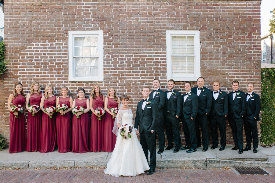 Elegant bridal party in long cranberry dresses and black tuxedos  //  Charleston wedding photography by Riverland Studios  //  A Lowcountry Wedding Magazine & Blog