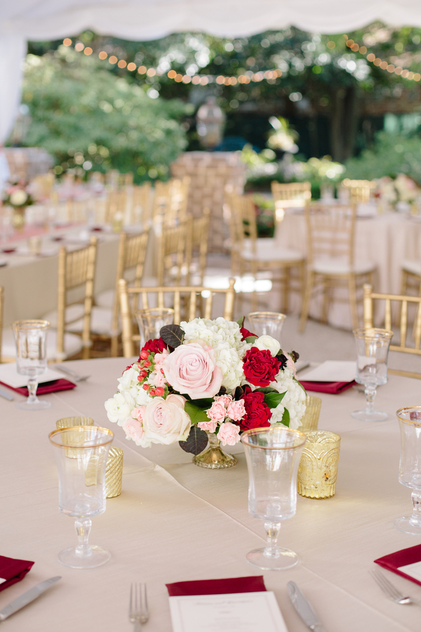 Fall centerpieces of white hydrangeas and pink and red roses  //  Charleston wedding photography by Riverland Studios  //  A Lowcountry Wedding Magazine & Blog
