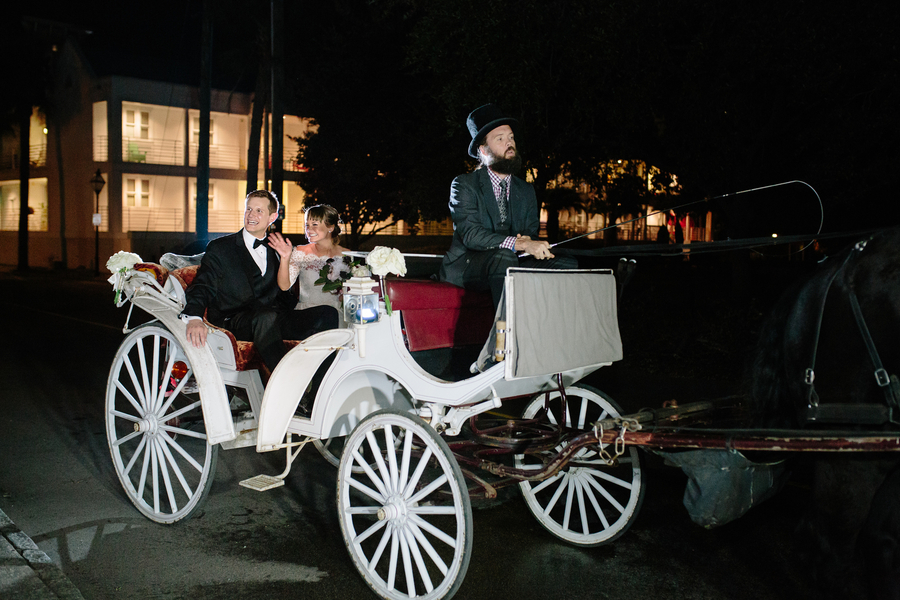 Bride & groom depart in a white horse and carriage from Charleston Coach  //  Charleston wedding photography by Riverland Studios  //  A Lowcountry Wedding Magazine & Blog
