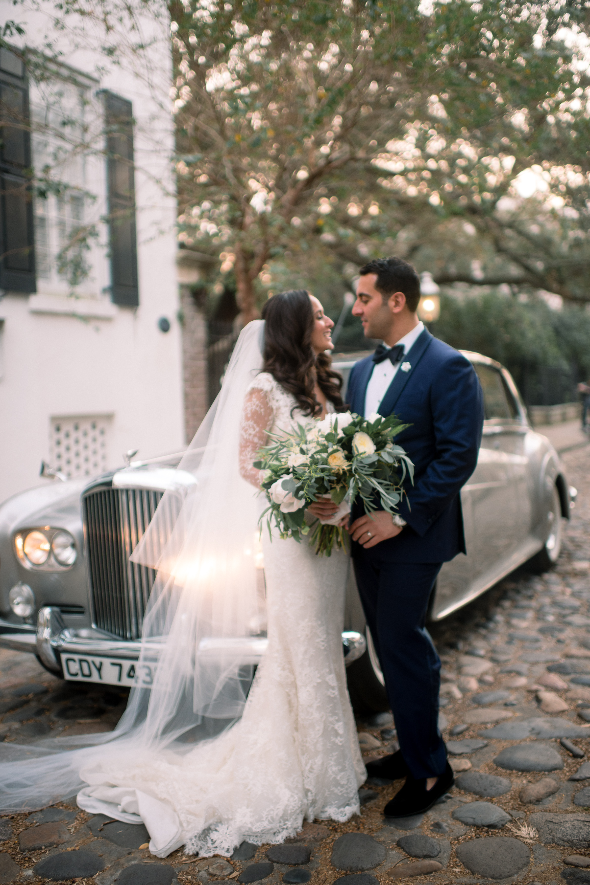 Charleston Bride wearing Ines di Santo gown in front of vintage Rolls Royce  //  A Lowcountry Wedding Magazine & Blog