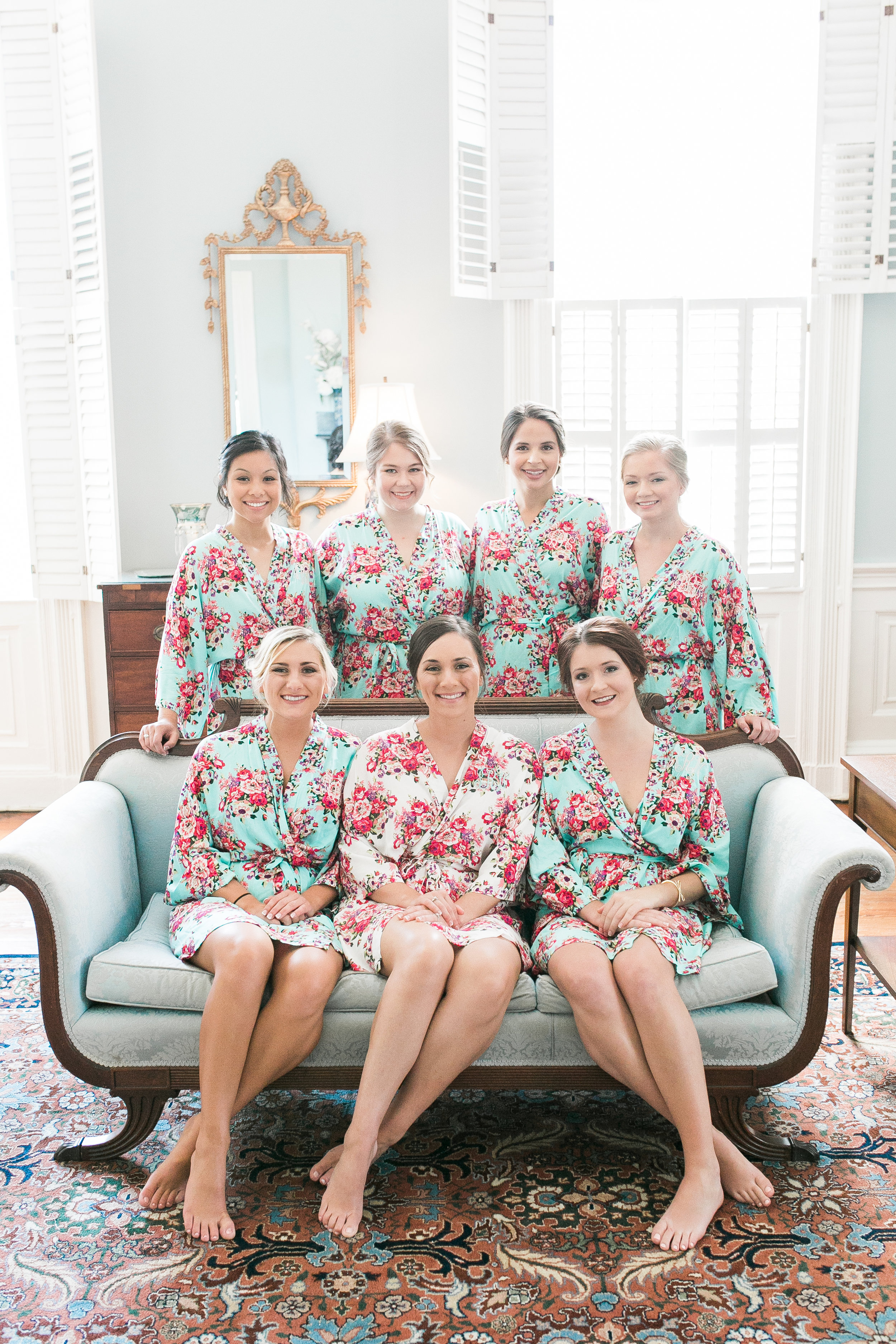 Bride with her bridesmaids in matching robes for a wedding at The Thomas Bennett House  //  A Lowcountry Wedding Magazine & Blog