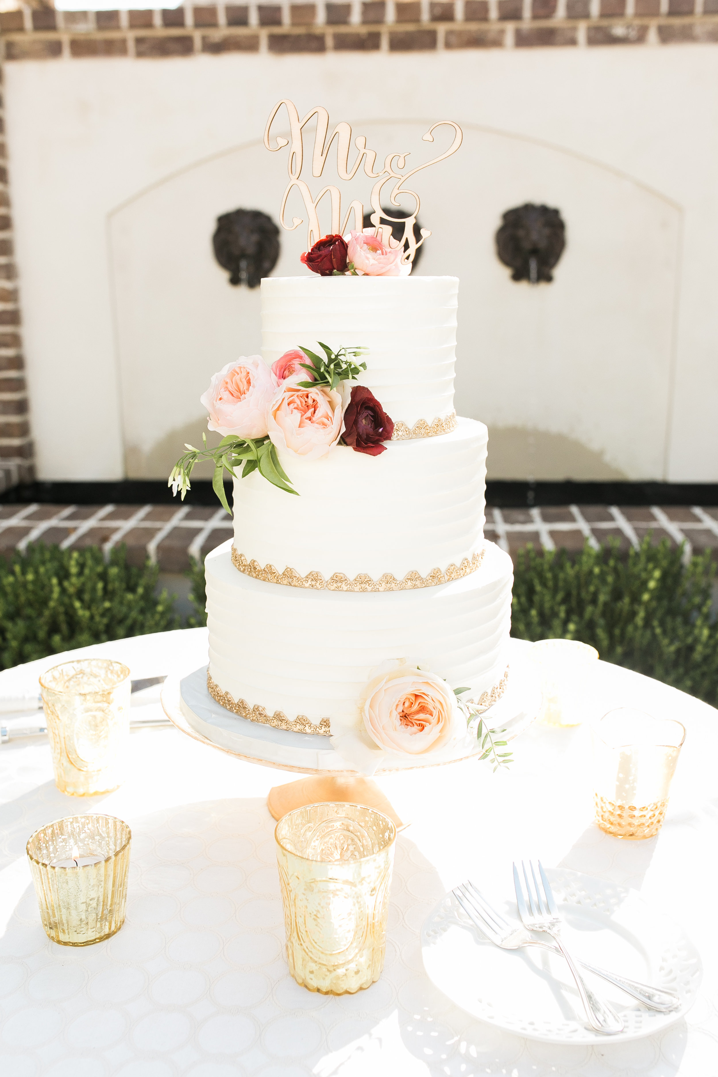 Elegant white cake with gold trim from ABCD Cakes at wedding in Charleston, SC  Colorful outdoor reception at The Thomas Bennett House wedding in Charleston, SC  //  photographed by Jenna Weddings  Traditional wedding ceremony at Cathedral of St. John the Baptist in Charleston, SC  //  A Lowcountry Wedding Magazine & Blog
