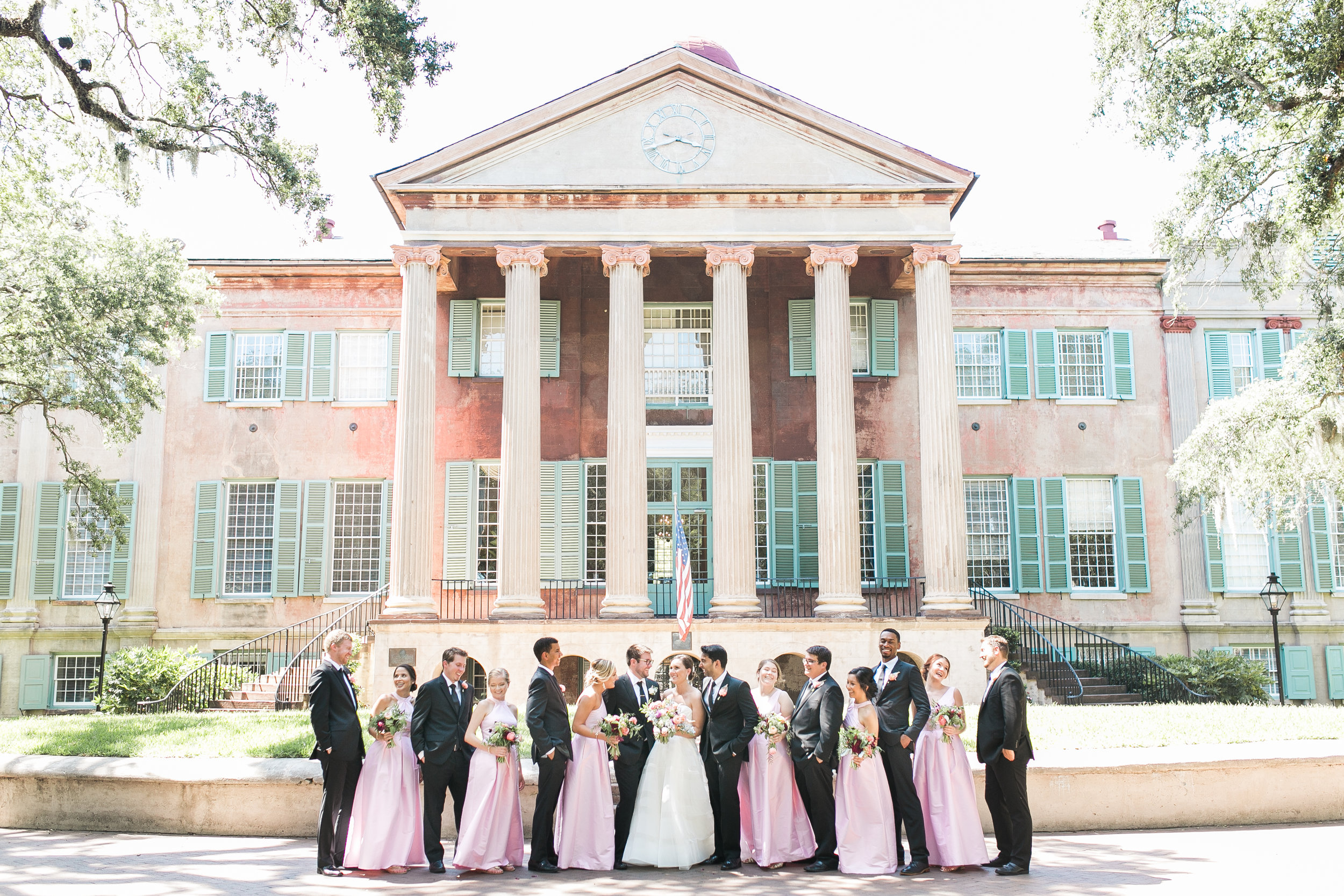 Charleston wedding portraits in front of the College of Charleston's Cistern by Jenna Marie Weddings  Colorful outdoor reception at The Thomas Bennett House wedding in Charleston, SC  //  photographed by Jenna Weddings  Traditional wedding ceremony at Cathedral of St. John the Baptist in Charleston, SC  //  A Lowcountry Wedding Magazine & Blog