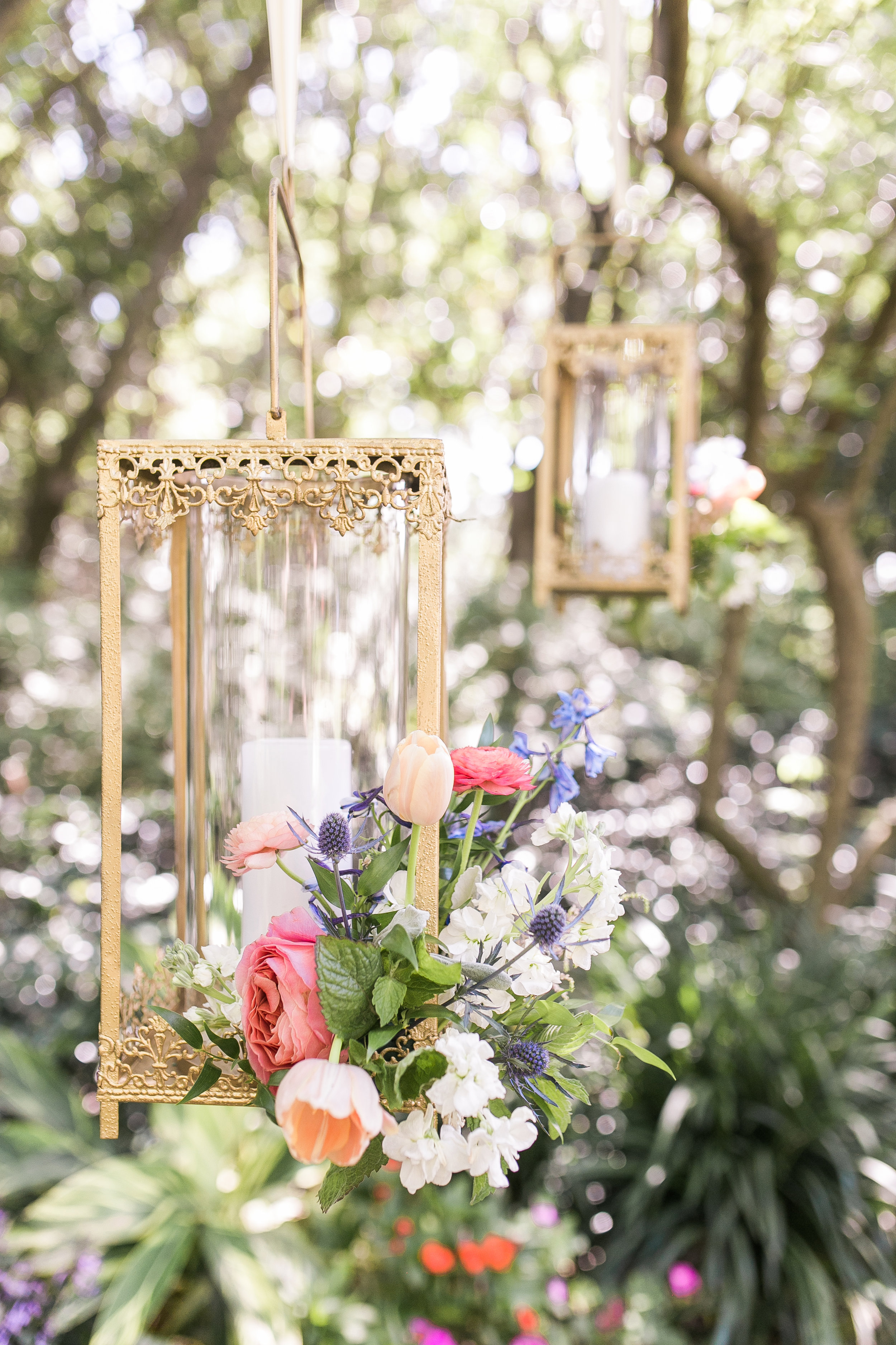 Gold lanterns with floral accents by Branch Design Studio  Colorful outdoor reception at The Thomas Bennett House wedding in Charleston, SC  //  photographed by Jenna Weddings  Traditional wedding ceremony at Cathedral of St. John the Baptist in Charleston, SC  //  A Lowcountry Wedding Magazine & Blog